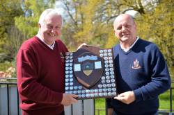Belfairs winning captain Chris Shawyer recieves the Roger Foreman Shield from Southend's Dave Burgess